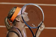 Maria Sharapova of Russia reacts after winning her women's semi-final match against Eugenie Bouchard of Canada at the French Open tennis tournament at the Roland Garros stadium in Paris June 5, 2014.          REUTERS/Gonzalo Fuentes