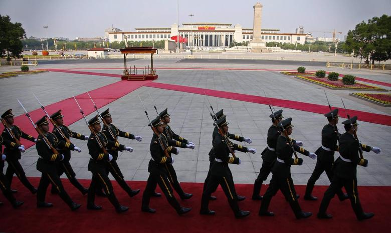 Soldiers from the honour guards of the Chinese People's Liberation Army (PLA) march in front of the Monument to the People's Heroes at Tiananmen Square, after the welcoming ceremony for Kuwait's Prime Minister Sheikh Jaber al-Mubarak al-Sabah at the Great Hall of the People, in Beijing, June 3, 2014. REUTERS/Petar Kujunzic