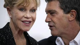 "Actor Antonio Banderas and wife Melanie Griffith arrive for the premiere of the movie ""Black Nativity"" at the Apollo Theatre in the Harlem area of New York November 18, 2013.    REUTERS/Carlo Allegri"