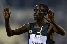 Ezekiel Kemboi of Kenya celebrates his victory in the men's  3000m Steeplechase during the IAAF Diamond League athletics meet in Doha May 9, 2014. REUTERS/Fadi Al-Assaad