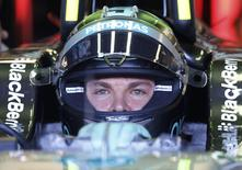 Mercedes driver Nico Rosberg of Germany sits in his car during the third free practice of the Canadian F1 Grand Prix at the Circuit Gilles Villeneuve in Montreal June 7, 2014. REUTERS/Chris Wattie