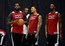 Miami Heat forward LeBron James (6) handles the ball during practice before game 2 of the 2014 NBA Finals at Spurs Practice Facility. Mandatory Credit: Bob Donnan-USA TODAY Sports