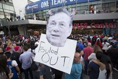 A supporter holds a photo cutout of Los Angeles Clippers owner Donald Sterling while standing in line for the NBA Playoff game 5 between Golden State Warriors and Los Angeles Clippers at Staples Center in Los Angeles, California April 29, 2014. REUTERS/Mario Anzuoni