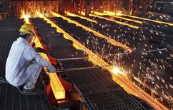 A worker cut steel bars at a steel plant in Ganyu, Jiangsu province June 9, 2014. China's consumer inflation edged up to a four-month high of 2.5 percent in May while factory price deflation eased, reinforcing signs of stabilization in the economy. Picture taken June 9, 2014. REUTERS/China Daily (CHINA - Tags: BUSINESS) CHINA OUT. NO COMMERCIAL OR EDITORIAL SALES IN CHINA