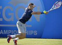 Bulgaria's Grigor Dimitrov returns the ball during his men's singles tennis match victory over Britain's James Ward at the Queen's Club Championships tennis tournament in west London, June 10, 2014. REUTERS/Toby Melville