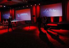 People stand at the Ontario Liberal Party leader Kathleen Wynne's election party headquarters in Toronto, June 12, 2014.    REUTERS/Mark Blinch