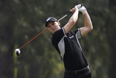 Kaymer leads Open by six shots in record style