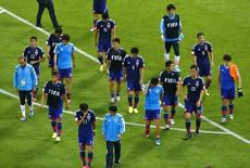 Team Japan walk off the pitch after the 2014 World Cup Group C soccer match between Ivory Coast and Japan at the Pernambuco arena in Recife June 14, 2014. REUTERS/Ruben Sprich