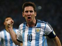Argentina's Lionel Messi celebrates scoring a goal during the 2014 World Cup Group F soccer match against Bosnia and Herzegovina at the Maracana stadium in Rio de Janeiro June 15, 2014. REUTERS/Michael Dalder (BRAZIL  - Tags: SOCCER SPORT WORLD CUP)