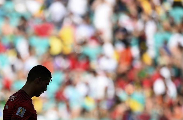 A silhouette of Portugal's Cristiano Ronaldo is seen reacting during their 2014 World Cup Group G soccer match agaisnt Germany at the Fonte Nova arena in Salvador, June 16, 2014. REUTERS/Dylan Martinez