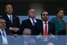 United Nations Secretary-General Ban Ki-moon (L) and Brazil's President Dilma Rousseff (R top) watch the match between Brazil and Croatia during the 2014 World cup opening match  at the Corinthians arena in Sao Paulo June 12, 2014. REUTERS/Kai Pfaffenbach
