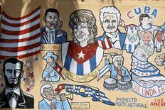 """Cuban-themed murals adorn the buildings along SW 8th Street, known locally as """"Calle Ocho"""" in the Little Havana neighborhood of Miami, Florida May 17, 2014. REUTERS/Brian Blanco"""