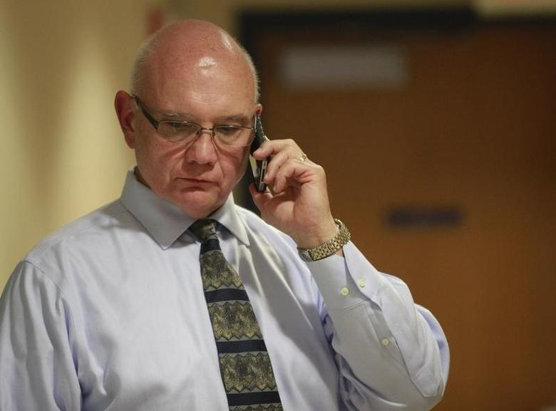 Acting Penn State athletic director David Joyner talks on a phone before a trustees meeting on the school's Worthington Scranton campus in Dunmore, Pennsylvania July 13, 2012.  REUTERS/Eric Thayer
