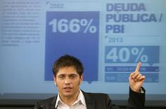 """Argentina's Economy Minister Axel Kicillof announces what the government will do following a major setback in its long-running legal battle against """"holdout"""" investors in Buenos Aires June 17, 2014.    REUTERS/Enrique Marcarian"""