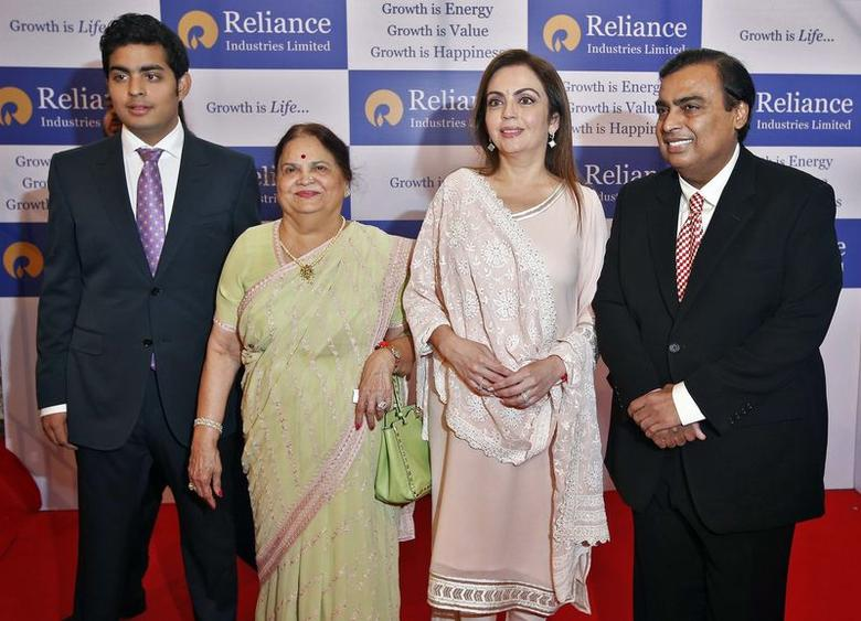 Mukesh Ambani (R), chairman of Reliance Industries Ltd, poses with his wife Nita (2nd R), mother Kokilaben (2nd L) and son Akash, before addressing the company's annual shareholders' meeting in Mumbai June 18, 2014. REUTERS/Stringer