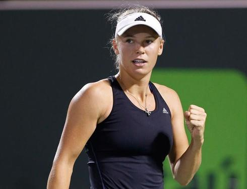 Happy Wozniacki back in the groove on Eastbourne grass
