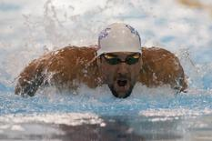Michael Phelps swims in the 100 meter butterfly final at Mecklenburg County Aquatic Center. Mandatory Credit: Jeremy Brevard-USA TODAY Sports - RTR3PJQY