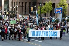 Demonstrators protest on the streets following the federal government's approval of the Enbridge's Northern Gateway pipeline in Vancouver, British Columbia June 17, 2014.   REUTERS/Ben Nelms