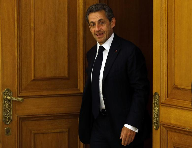 Former French President Nicolas Sarkozy arrives for a meeting with Spanish King Juan Carlos at Zarzuela Palace outside Madrid May 27, 2014. REUTERS/Susana Vera