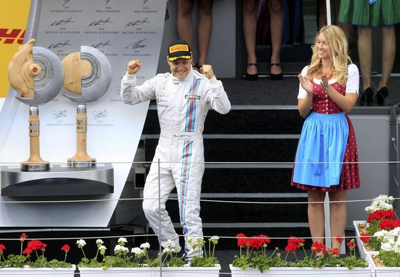 Third placed Williams Formula One driver Valtteri Bottas of Finland elebrates after the Austrian F1 Grand Prix at the Red Bull Ring circuit in Spielberg June 22, 2014. REUTERS/Bernadett Szabo