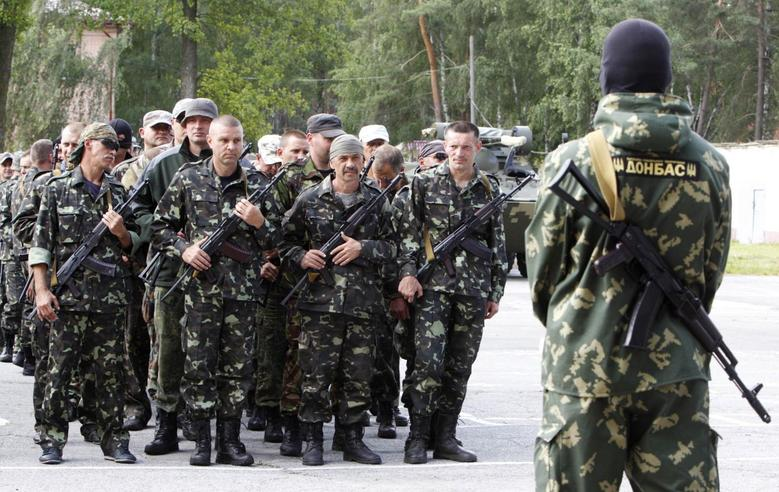 Fighting strains Ukraine ceasefire, Putin urges...