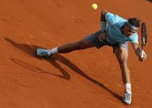 Rafael Nadal of Spain returns the ball to Novak Djokovic of Serbia during their men's singles final match at the French Open Tennis tournament at the Roland Garros stadium in Paris June 8, 2014.       REUTERS/Gonzalo Fuentes