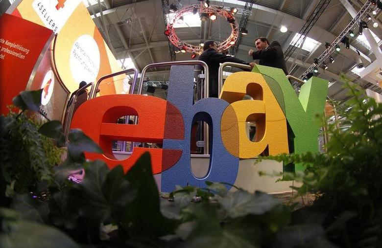 Visitors chat next to the Ebay logo at the CeBIT computer fair in Hanover March 2, 2011.REUTERS/Tobias Schwarz