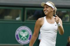 Sabine Lisicki of Germany reacts after defeating Julia Glushko of Israel in their women's singles tennis match at the Wimbledon Tennis Championships, in London June 24, 2014.  REUTERS/Suzanne Plunkett