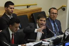 """Argentina's Economy Minister Axel Kicillof (C) gives an address """"Sovereign Debt Restructuring: The Case of Argentina"""" next to Sacha Llorenti (L), Chairman of the Group of G77 at United Nations headquarters in New York June 25, 2014. REUTERS/Lucas Jackson"""