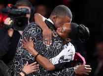 Andrew Wiggins (Kansas) gets a hug after being selected as the number one overall pick to the Cleveland Cavaliers in the 2014 NBA Draft at the Barclays Center. Mandatory Credit: Brad Penner-USA TODAY Sports