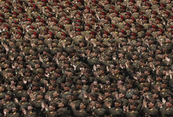 Soldiers applaud North Korea leader Kim Jong-un during a ceremony at a stadium in Pyongyang, April 14, 2012.  REUTERS-Bobby Yip