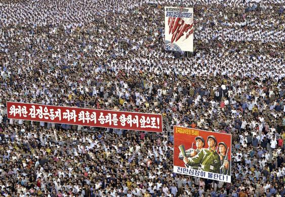 People attend a mass rally against U.S. Imperialists at Kim Il Sung Square in Pyongyang in this undated photo released June 25, 2014. REUTERS-KCNA