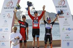 Overall winner Team Sky rider Chris Froome of Britain (C), runner-up BMC rider Tejay van Garderen of the U.S. (2nd L) and second runner-up Omega Pharma Quick-Step rider Rigoberto Uran of Columbia (R) celebrate on the podium after the Tour of Oman cycling race in Muscat February 23, 2014.  REUTERS/Hamad I Mohammed