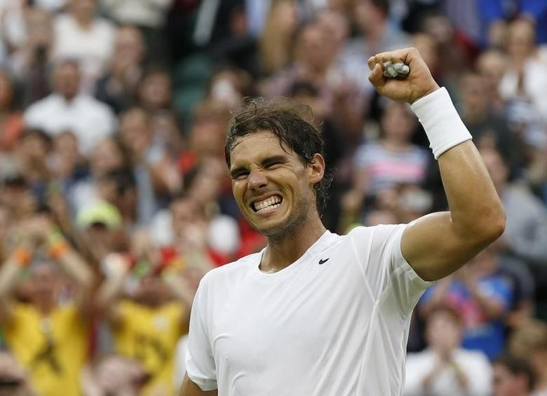 Rafael Nadal of Spain reacts after defeating Mikhail Kukushkin of Kazakhstan in their men's singles tennis match at the Wimbledon Tennis Championships, in London June 28, 2014. REUTERS/Suzanne Plunkett