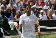 Grigor Dimitrov of Bulgaria reacts during his men's singles quarter-final tennis match against Andy Murray of Britain at the Wimbledon Tennis Championships, in London July 2, 2014. REUTERS/Suzanne Plunkett