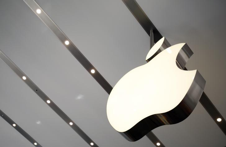 The Apple logo is pictured inside the newly opened Omotesando Apple store at a shopping district in Tokyo June 26, 2014. Picture taken June 26. REUTERS/Yuya Shino