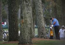 U.S. golfer Kevin Stadler hits a shot from the trees on the first hole during the final round of the Masters golf tournament at the Augusta National Golf Club in Augusta, Georgia April 13, 2014. REUTERS/Jim Young/Files