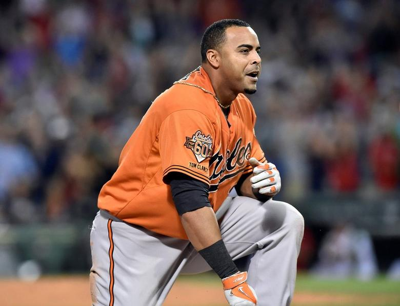 Jul 5, 2014; Boston, MA, USA; Baltimore Orioles left fielder Nelson Cruz (23) reacts after being tagged out at third base during the eighth inning in game two against the Boston Red Sox at Fenway Park. Mandatory Credit: Bob DeChiara-USA TODAY Sports