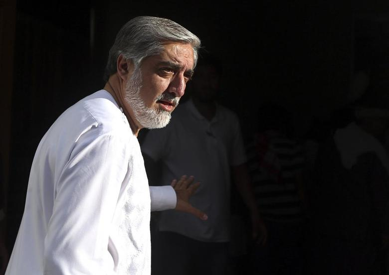 Afghan presidential candidate Abdullah Abdullah arrives for a news conference in Kabul, July 6, 2014.REUTERS/Omar Sobhani