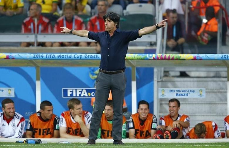 Germany's coach Joachim Loew reacts during his team's 2014 World Cup semi-finals against Brazil at the Mineirao stadium in Belo Horizonte July 8, 2014. REUTERS/Ruben Sprich