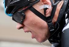 Team Sky rider Christopher Froome of Britain cycles after he fell during the 155.5 km fifth stage of the Tour de France cycling race from Ypres Belgium to Arenberg Porte du Hainaut July 9, 2014.    REUTERS/Christian Hartmann