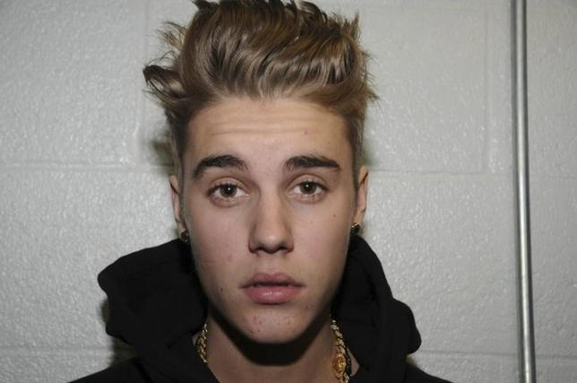 Canadian pop singer Justin Bieber is pictured in police custody in Miami Beach, Florida January 23, 2014 in this Miami Beach Police Department handout released to Reuters on March 4, 2014.  REUTERS/Miami Beach Police Dept./Handout via Reuters