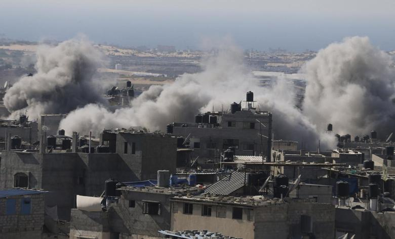 Gaza rockets land deep in Israel as it bombards...