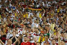 Germany's fans celebrate their 2014 World Cup final win against Argentina at the Maracana stadium in Rio de Janeiro July 13, 2014. REUTERS/Damir Sagolj (BRAZIL  - Tags: SOCCER SPORT WORLD CUP)