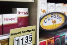 Newport cigarettes are stacked on a shelf inside a tobacco store in New York July 11, 2014.  REUTERS/Lucas Jackson