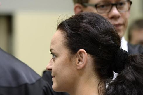Defendant in German neo-Nazi murder trial wants to fire lawyers