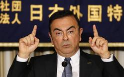 Nissan Motor Co's President and Chief Executive Officer Carlos Ghosn gestures as he speaks at a news conference at the Foreign Correspondents' Club of Japan in Tokyo July 17, 2014.    REUTERS/Toru Hanai