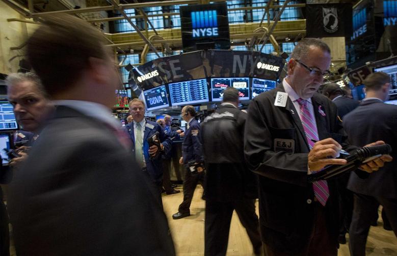 Traders work on the floor of the New York Stock Exchange July 16, 2014. REUTERS/Brendan McDermid