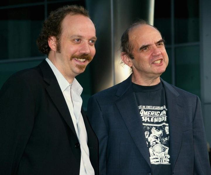 Actor Paul Giamatti (L) star of the film ''American Splendor'' arrivesfor the film's premiere in Hollywood August 7, 2003 with comic bookcreator Harvey Pekar.  REUTERS/Fred Prouser