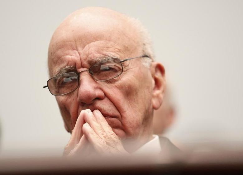 News Corporation CEO Rupert Murdoch waits to testify before the House Immigration, Citizenship, Refugees, Border Security and International Law Subcommittee on Capitol Hill in Washington September 30, 2010. REUTERS/Richard Clement